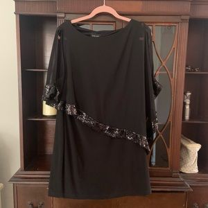 Beautiful black dress with attached sheer top.